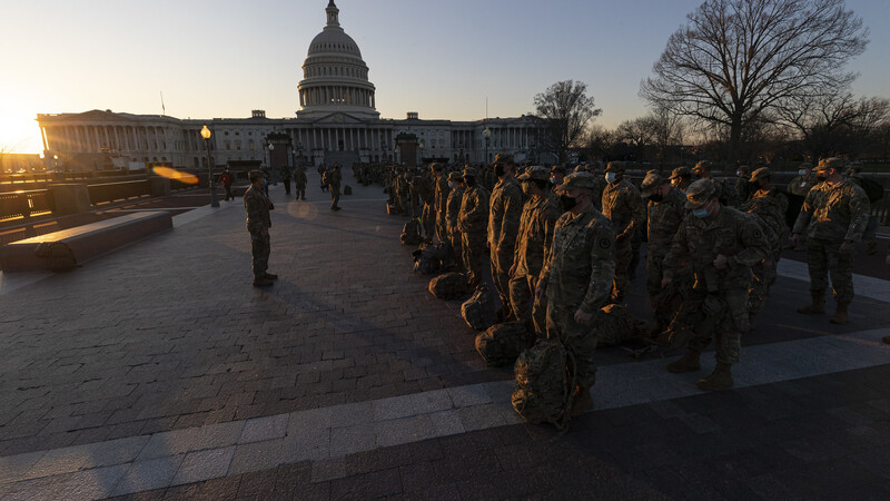 Fort Capitol: Hundreds of National Guard troops sleep with their rifles on Congress stone floor