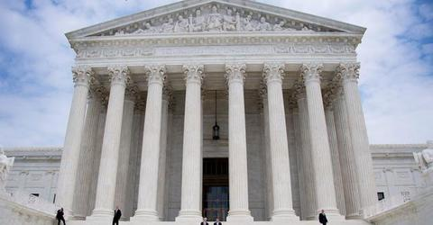 Supreme Court dismisses 1 of 2 challenges to Trump travel ban