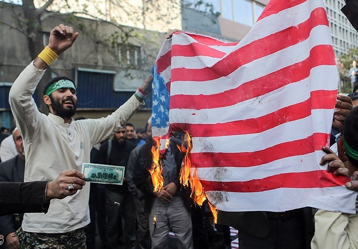 Fire Sale: An Iran Plant Makes The US Flags Protesters Burn