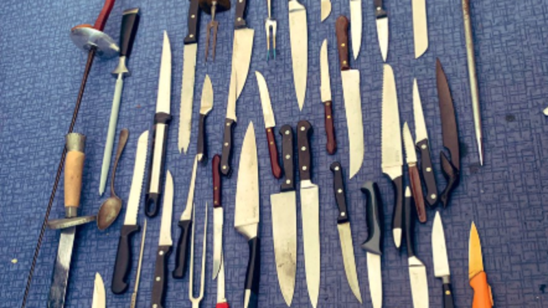 The UK has gone mad': Cops show knives they collected so they 'don't get into the wrong hands' — along with a spoon