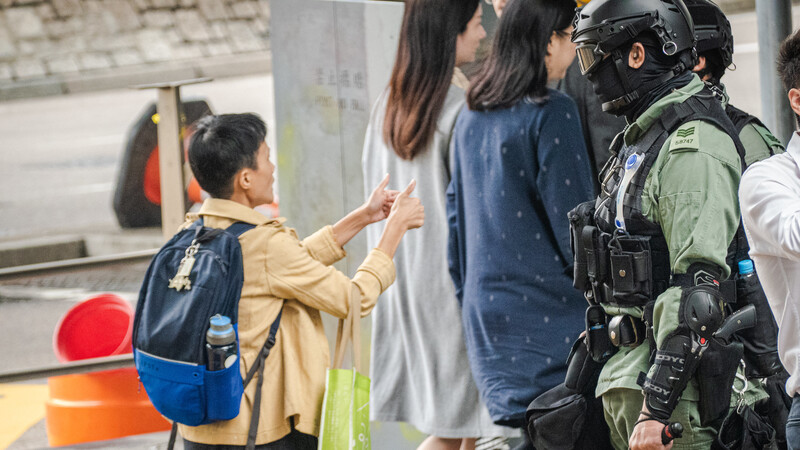 Hong Kong police pepper-spray a pregnant woman before tackling her to the ground in front of a screaming crowd as anti-government chaos continues to spiral