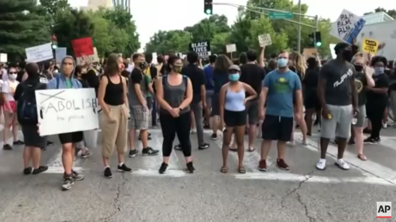 Hundreds Of 'Justice' Protesters Return To Armed Couple's Home