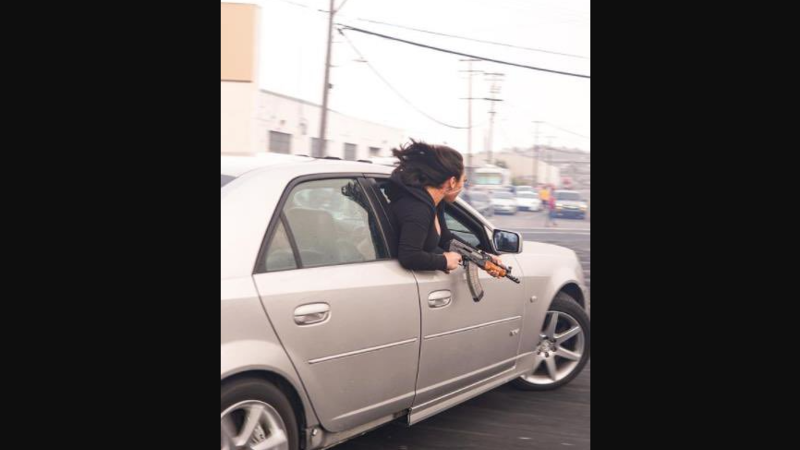 Woman seen leaning out of car holding AK-47 in Gun Controlled San Francisco