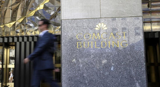 Comcast pulls in first full-year gain in TV customers in a decade