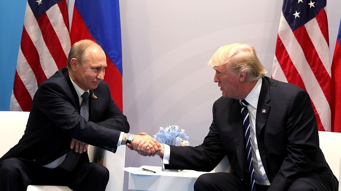 Back in Washington, Trump under pressure to reverse course on Russia