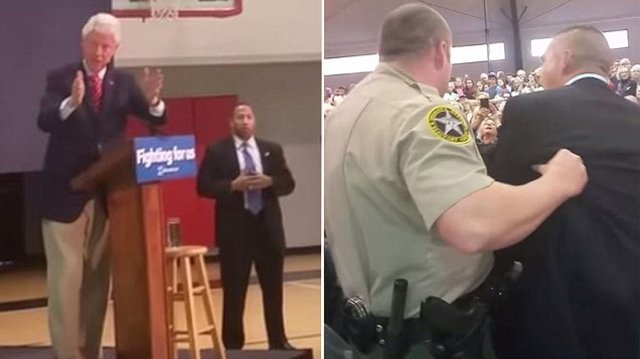 Man claiming to be Marine says Clinton tried to 'cover' up Benghazi, removed from campaign rally