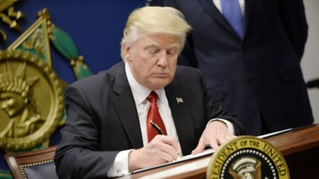 Trump signs order temporarily halting admission of refugees, promises priority for Christians